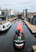 View of Union Canal at Lochrin Basin with narrow boat sailing to mooring at Fountainbridge in Edinburgh, Scotland, United Kingdom, UK Iain Masterton /Scottish Viewpoint Union Canal,Lochrin Basin,Edinburgh,canals,property development,Scotland,Scottish,city,cities,daytime,narrow boat,outdoor,UK,United Kingdom,waterway,waterways,district,Union canal Lochrin Basin,Union