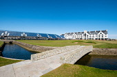 View of Carnoustie Golf Course Hotel behind 18th Green with Barry Burn and bridge  in foreground at Carnoustie Golf Links in Carnoustie, Angus, Scotland, UK. Carnoustie is venue for the 147th Open Cha... Iain Masterton /Scottish Viewpoint Carnoustie,Carnoustie Golf Links,Carnoustie Golf Course,Carnoustie Golf Hotel,Carnoustie Golf course hotel,spa,hotels,travel,tourism,building exterior,luxury,Angus,Scotland,Scottish,UK,united Kingdom,
