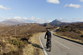 Cyclist on A894 North Coast 500 route near Laxford Bridge in Sutherland, Scotland, Highlands of Scotland Mark Ferguson /Scottish Viewpoint uk,u.k,Great Britain,GB,G.B,Scotland,Scottish,1 person,daytime,outdoors,A894,north coast 500,cycling,cyclist,highland,sutherland,nc 500,road,highlands,ben stack,mountain,quiet,remote,sunny,blue sky,le