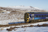 Scotrail Northern Line train between Kinbrace and Forsinard in Sutherland. Highlands of Scotland Mark Ferguson /Scottish Viewpoint uk,u.k,Great Britain,GB,G.B,Scotland,Scottish,nobody,daytime,outdoors,winter,train,scotrail,northern line,snow,scenic,landscape,Sutherland,flow country,remote,blue sky,ben griam mor,ben griam beag,kin