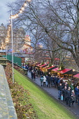 Edinburgh Christmas lights and festivities, Princes Street Gardens, Scotland, UK. Dennis Barnes /Scottish Viewpoint uk,u.k,Great Britain,GB,G.B,Scotland,Scottish,people,daytime,outdoors,xmas,Edinburgh,city,Christmas,lights,market,festivities,Princes,Street,Gardens