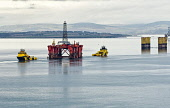 In January 2013, the refit of an oil drilling platform at Nigg Yard, Nigg, Easter Ross, was completed.  .Here, the rig, which has been in dry dock for several months, on tow towards Invergordon viewed... 2013,Highlands,Islands,Enterprise,Cromarty,Firth,platform,drill,drilling,gas,energy,carbon,industry,industrial,Global,Park,fabrication,water,group,winter