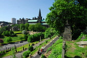 LOOKING ACROSS TO GLASGOW CATHEDRAL FROM THE NECROPOLIS - AN EXTENSIVE CEMETERY SPRAWLING OVER A HILLSIDE EAST OF GLASGOW CITY CENTRE. Chris Robson /Scottish Viewpoint ARCHITECTURE,TOMB,SUNNY,SUMMER,RELIGION,4 PEOPLE,MONUMENT,HISTORIC SCOTLAND,HERITAGE,GRAVES,GENEALOGY,BUILDING,NECROPOLIS