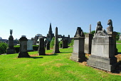 LOOKING ACROSS TO THE SPIRE OF GLASGOW CATHEDRAL FROM THE NECROPOLIS - AN EXTENSIVE CEMETERY SPRAWLING OVER A HILLSIDE EAST OF GLASGOW CITY CENTRE. Chris Robson /Scottish Viewpoint ARCHITECTURE,TOMB,SUNNY,SUMMER,RELIGION,MONUMENT,HISTORIC SCOTLAND,HERITAGE,GRAVES,GENEALOGY,BUILDING,NECROPOLIS