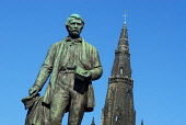 THE STATUE OF DAVID LIVINGSTONE WITH THE SPIRE OF  GLASGOW CATHEDRAL VISIBLE BEHIND, EAST OF GLASGOW CITY CENTRE. Chris Robson /Scottish Viewpoint ARCHITECTURE,SUNNY,SUMMER,RELIGION,MONUMENT,HISTORIC SCOTLAND,HERITAGE,BUILDING