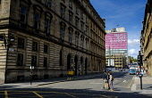 Looking up South Frederick Street, Glasgow Scotland towards George Square and the 'People Make Glasgow sign on the Glasgow College of Building and Printing. Andrew Wilson /Scottish Viewpoint uk,u.k,Great Britain,GB,G.B,Scotland,Scottish,group,daytime,outdoors,George Square,Glasgow College of Building and Printing,Glasgow Scotland,People Make Glasgow,South Frederick Street,Street Photograp