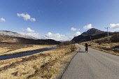 Cycling on A838 along River Laxford, Sutherland, Highlands of Scotland Mark Ferguson /Scottish Viewpoint uk,u.k,Great Britain,GB,G.B,Scotland,Scottish,1 person,daytime,outdoors,sutherland,cycling,cyclist,cyclists,bike,bikes,biking,biker,bikers,bicycle,bicycles,people,person,empty,road,highland,highlands