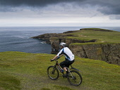 Yesnaby, Orkney Isle, Scotland Mark Ferguson /Scottish Viewpoint uk,u.k,Great Britain,GB,G.B,Scotland,Scottish,1 person,daytime,outdoors,island,islands,isle,isles,cycling,cyclist,cyclists,bike,bikes,biking,biker,bikers,bicycle,bicycles,mountain,people,person,cycle,