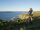 Brough of Birsay, Orkney, Scotland Mark Ferguson /Scottish Viewpoint uk,u.k,Great Britain,GB,G.B,Scotland,Scottish,1 person,daytime,outdoors,island,islands,isle,isles,cycling,cyclist,cyclists,bike,bikes,biking,biker,bikers,bicycle,bicycles,mountain,people,person,cycle,