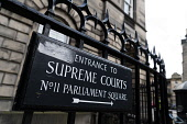 Sign at entrance to Parliament Square and the Supreme Courts ( Court of Session) in Edinburgh Old Town, Scotland, UK Iain Masterton /Scottish Viewpoint Edinburgh Supreme Courts,Supreme Courts Edinburgh,Court of Session Edinburgh,Edinburgh Court of Session,law courts,Scotland,Scottish,sign,Parliament Square Edinburgh,Edinburgh Parliament Square,daytim