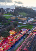 Overhead view of Edinburgh Christmas market in Princes Street Gardens at dusk with Edinburgh Castle in the background, Edinburgh, Scotland, UK Iain Masterton /Scottish Viewpoint Scotland,Scottish,Edinburgh Chritmas Market,Edinburgh,traditional,twilight,dusk,evening,city,scottish culture,annual,markets,UK,United Kingdom,Britain,Ecity,capital city,tourism,tourists,travel,winter