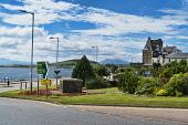 Looking north along Oban promenade, Argyll and Bute,  Scotland UK Dennis Barnes /Scottish Viewpoint uk,u.k,Great Britain,GB,G.B,Scotland,Scottish,2 people,daytime,outdoors,Oban,bay,promenade,seafront,Argyll,coast,coastal,coastline,water,sea,town