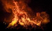 Biggar bonfire alight on hogmanay after lighting by resident Alan Michie Andrew Wilson/Scottish Viewpoint uk,u.k,Great Britain,GB,G.B,Scotland,Scottish,people,daytime,outdoors,2018,Biggar Bonfire,Hogmanay,South Lanarkshire,fire festival,new year,alight,burning,flames,fire