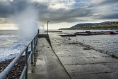 Storm seas at Helmsdale harbour, Sutherland Alan Gordon/Scottish Viewpoint Firths,Helmsdale,Highlands,Moray Firth,North Coast 500,North Sea,Scotland,Sutherland,atmospheric,autumn,bay,boat,cloudy,coast,dramatic,fishing,harbour,hills,jetty,landscape,mountains,nobody,pier,quay,