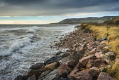 Looking south west down the Sutherland coast from just north of Helmsdale Alan Gordon/Scottish Viewpoint Firths,Helmsdale,Moray Firth,North Coast 500,North Sea,SSSI,Scotland,Sutherland,atmospheric,autumn,beach,boulders,cloudy,coast,hills,landscape,mountains,nobody,rocks,rocky,sea,shore,stormy,sunny,surf,