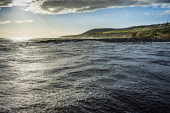 Heavy swell in the harbour, Helmsdale, Sutherland Alan Gordon/Scottish Viewpoint Firths,Helmsdale,Highlands,Moray Firth,North Coast 500,North Sea,Scotland,Sutherland,atmospheric,autumn,bay,breakwater,clouds,coast,dramatic,harbour,hills,landscape,mountains,nobody,sea,stormy,sunny,w