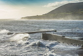 Heavy seas at Helmsdale harbour, Sutherland Alan Gordon/Scottish Viewpoint Firths,Helmsdale,Highlands,Moray Firth,North Coast 500,North Sea,Scotland,Sutherland,atmospheric,autumn,bay,breakwater,clouds,coast,dramatic,harbour,hills,landscape,mountains,nobody,pier,quay,sea,spra