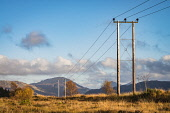 Power line above Reraig, Balmacara, with Sgurr an Airgid and the Five Sisters of Kintail Alan Gordon/Scottish Viewpoint Balmacara,Corbett,Highlands,Lochalsh,Munro,National Grid,Scotland,afternoon,atmospheric,autumn,cables,energy,hills,landscape,mountains,nobody,power,power line,pylon,sun,sunlight,sunny,transmission,tre