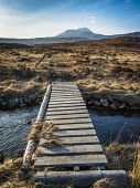 Footbridge over the River Loanan below Canisp (847m) in Assynt, Sutherland Alan Gordon/Scottish Viewpoint Assynt,Corbett,Cul Mor,Highlands,National Scenic Area,North Coast 500,SSSI,Scotland,Sutherland,afternoon,atmospheric,autumn,bridge,burn,climbing,dramatic,footbridge,footpath,hills,hillwalking,landscap