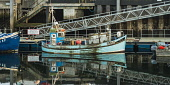 Fishing boat in the harbour at Ullapool, Ross-shire Alan Gordon/Scottish Viewpoint Highlands,North Coast 500,Ross and Cromarty,Scotland,Ullapool,boat,calm,evening,fishing,harbour,nobody,pier,quay,reflection,sea,sea loch,still,water