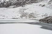 Snow and ice on Loch Coire nan Crogachan, above Glen Shiel Alan Gordon/Scottish Viewpoint Glen Shiel,Highlands,Kintail,National Scenic Area,Scotland,abstract,atmospheric,cliff,cold,crag,frozen,hills,ice,landscape,loch,lochan,mountains,nature,nobody,rocks,snow,wild,wilderness,winter