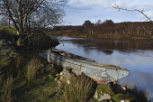abandoned boat;river ewe;poolewe;wester ross;scotland Mark Hicken/Scottish Viewpoint uk,u.k,Great Britain,GB,G.B,Scotland,Scottish,nobody,daytime,outdoors,abandoned boat,boat,boulders,trees,reflection,river,river ewe,metal,hull,shoreline,steel,picturesque,poolewe,wester ross,water