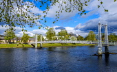 A footbridge over the River Ness in Inverness, Scotland Andrew Wilson/Scottish Viewpoint uk,u.k,Great Britain,GB,G.B,Scotland,Scottish,1 person,daytime,outdoors,Inverness,River Ness,highland capital,highlands of Scotland,spring,springtime,city,highlands