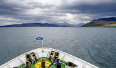 Caledonian MacBrayne ferry 'Loch Nevis' approaching Mallaig, Scotland with the Isle of Skye in the background Andrew Wilson/Scottish Viewpoint uk,u.k,Great Britain,GB,G.B,Scotland,Scottish,nobody,daytime,outdoors,Isle of Skye,Loch Ness,Mallaig,Saltire,calm,car ferry,ferry,flag,fluttering,west coast,western isles,caledonian,macbrayne,cal,mac,
