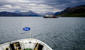 Caledonian MacBrayne ferry 'Lord of the Isles' leaving Mallaig, Scotland with the Isle of Skye in the background Andrew Wilson/Scottish Viewpoint uk,u.k,Great Britain,GB,G.B,Scotland,Scottish,nobody,daytime,outdoors,Caledonian MacBrayne,Isle of Skye,Mallaig,Saltire,calm.,car ferry,ferry,fluttering,west coast,caledonian,macbrayne,cal,mac,calmac,