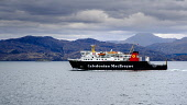 Caledonian MacBrayne ferry 'Lord of the Isles' leaving Mallaig, Scotland with the Isle of Skye in the background Andrew Wilson/Scottish Viewpoint uk,u.k,Great Britain,GB,G.B,Scotland,Scottish,nobody,daytime,outdoors,Caledonian MacBrayne,Isle of Skye,Mallaig,calm.,car ferry,ferry,west coast,caledonian,macbrayne,cal,mac,calmac,ferries,transport,t