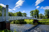 A footbridge over the River Tweed in the borders town of Peebles, Scotland Andrew Wilson/Scottish Viewpoint uk,u.k,Great Britain,GB,G.B,Scotland,Scottish,2 people,daytime,outdoors,footbridge,spring,springtime,sunshine,Scottish Borders,Peebles,River Tweed