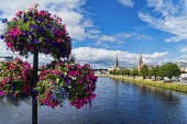 Inverness,  from ness road bridge, River Ness, Highlands, Scotland, UK Dennis Barnes/Scottish Viewpoint uk,u.k,Great Britain,GB,G.B,Scotland,Scottish,group,daytime,Inverness,River,Ness,sunny,castle,road,bridge,flowers,hanging,baskets,Highland,city,vista,cities,town
