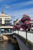 Inverness,  from ness road bridge, River Ness, Highlands, Scotland, UK Dennis Barnes/Scottish Viewpoint uk,u.k,Great Britain,GB,G.B,Scotland,Scottish,group,daytime,Inverness,River,Ness,sunny,road,bridge,flowers,hanging,baskets,Highland,city,cities,town,centre