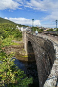 Helmsdale, River, old bridge, Sutherland coast, Highlands Region, Scotland UK Dennis Barnes/Scottish Viewpoint uk,u.k,Great Britain,GB,G.B,Scotland,Scottish,1 person,daytime,Helmsdale,River,old,bridge,sunny,Sutherland,coast,Highland,village
