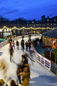 Edinburgh Christmas lights and festivities, skating rink,  St Andrews Square, Scotland, UK. Dennis Barnes/Scottish Viewpoint uk,u.k,Great Britain,GB,G.B,Scotland,Scottish,group,nightime,Edinburgh,city,Christmas,lights,festivities,skating,rink,St,Andrews,Square,Lothian,xmas,skaters