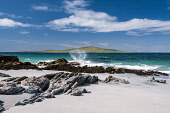 view to pabbay from berneray with rock and surf, North Uist Allan Wright/Scottish Viewpoint uk,u.k,Great Britain,GB,G.B,Scotland,Scottish,nobody,daytime,outdoors,North uist,berneray,outer hebrides,western isles,bird bright,gentle,enchanting,hebridean,peaceful,romantic,remote,rugged,summer,su