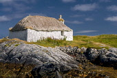 Traditional house on shore, Isle  of  north uist Allan Wright/Scottish Viewpoint uk,u.k,Great Britain,GB,G.B,Scotland,Scottish,nobody,daytime,outdoors,outer hebrides,western isles,crofting,farming,blue sky,bright,dry,gentle,hebridean,peaceful,summer,sunny,blue,white,green,seaweed,
