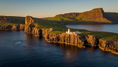 An aerial photograph of late evening light over the remote Neist Point Lighthouse on the Isle of Skye, Scotland Jason Baxter /Scottish Viewpoint aerial,aerial photograph,beauty,cliff,cliffs,coast,coastal,dusk,evening light,isle of skye,lighthouse,neist point,peninsula,remote,rugged coastline,scenery,scenic,scotland,scottish,scottish coast,summ