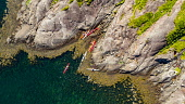 An aerial view of Kayakers exploring the remote Loch na Cuilce by the Cuillin mountain range on a summers day.  Isle of Skye Jason Baxter /Scottish Viewpoint Loch na Cuilce,aerial,aerial photograph,exploration,exploring,isle of skye,kayaking,loch,nature,quiet,remote,rugged,scenery,scenic,scotland,scottish,scottish highlands,serene,summer,sunny,tourist dest