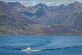 A boat-trip returns from Loch Coruisk to Elgol on a summers day, Isle of Skye, Scotland Jason Baxter /Scottish Viewpoint Black Cuillins,Cuillins,bay,beauty,boat,boat-trip,coast,coastal,elgol,geography,inner hebrides,isle of skye,landscape,lesuire craft,mountainous,mountains,remote,rugged,rural landscape,rural scenic,sce