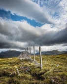 Old snow fence by the A832 road near Braemore, Wester Ross, with the Fannich hills in trhe background Alan Gordon  /Scottish Viewpoint Dundonnell,Fannichs,Highlands,Munro,Ross and Cromarty,Scotland,Wester Ross,atmospheric,autumn,clouds,cloudy,derelict,fence,fencepost,hills,landscape,mountains,nobody,old,ruin,snow,sunny,travel