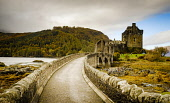 Eilean Donan Castle on the shores of Loch Duich on the road to the Isles and Skye, Highlands  of Scotland Andrew Wilson  /Scottish Viewpoint Castle,Eilean Donan Castle,Loch Duich,autumn colours,calm,fall colors,famous,highlands of Scotland,history,loch side,monument,most photographed,peaceful,tourist attraction,people