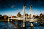 A cast iron footbridge over the river Ness in Inverness, Scotland Andrew Wilson  /Scottish Viewpoint Inverness,River Ness,Riverbank,Tourist Destination,autumn,colour,cold,crossing,fall color,fast flowing,footbridge,highlands of Scotland,river crossing,riverside,sunny,day,sunshine,water,bridges,people