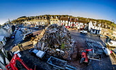 The huge Biggar hogmanay bonfire in the High Street, which will be lit by local resident Bobby Boyd MBE at 9.30pm tonight (Hogmanay - 31st December 2019).  This is probably the biggest new year bonfir... Andrew Wilson  /Scottish Viewpoint Biggar,South Lanarkshire,Scotland,hogmanay,tradition,new years eve,bonfire,high Street,fire festival,winter festival,pagan ritual,biggest bonfire,local tradition