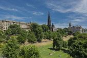 Looking across Princes Street Gadrens Edinburgh Scotland to the Scott Monument, D.G.Farquhar  /Scottish Viewpoint Britain,Edinburgh,GB,Monument,Princes Street Gardens,Scotland,United Kingdom,sun bathing,sunbathers,people,summer,city,scene