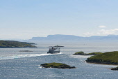 MV Hebrides ferry sets sail from tarbert, harris Allan Wright  /Scottish Viewpoint outer hebrides,harris,tarbert,western isles,caledonian macbrayne,calmac,mv hebrides,sea,atlantic,hebridean,remote,peaceful,sailing,blue sky,bright,distant,dry,high pressure,summer,cool,blue,headland,i