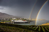 MV Hebrides ferry docks at Tarbert, Harris, Outer Hebrides with rainbows Allan Wright  /Scottish Viewpoint dramatic,double rainbow,rainbow,hebridean,moody,changeable,stormy,colourful,sea,boats,coastal path,ferry,harbour,port,pier,village,hamlet,town,calmac,mv hebrides,outer hebrides,western isles,harris,ta