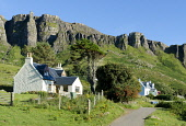 Houses on Isle of Eigg, with the Scaur, escarpment, Inner Hebrides Allan Wright  /Scottish Viewpoint uk,u.k,Great Britain,GB,G.B,Scotland,Scottish,nobody,daytime,outdoors,summer,restful,remote,peaceful,tranquil,bright,sunny,colourful,island,community owned,Isle of Eigg Community,eigg,small isles,west
