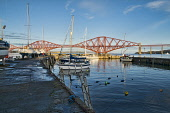 Looking from Old Harbour, South Queensferry, to iconic Forth Rail Bridge, West Lothian, Scotland UK Dennis Barnes /Scottish Viewpoint Old,harbour,South,Queensferry,Forth,Railway,Bridge,iconic,boats,evening,light,magic,hour,sunny,Scottish,UK,United Kingdom,water