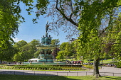 Princes street gardens, ross fountain,  sunny summer day,  Edinburgh, Scotland, UK. Dennis Barnes /Scottish Viewpoint Edinburgh,summer,blossom,trees,fountain,Princes,street,gardens,sunny,city,centre,Lothian,Scottish,landscape,Region,UK,United Kingdom,people